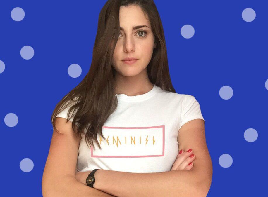 girl wearing a white feminist shirt